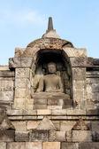 Statue de bouddha à l'intérieur du mur de temple de borobudur — Photo