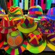 Colourfull and bright hats for nightparty - Stock Photo