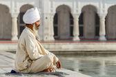 Sikh in a obliteration prayer — Stock Photo
