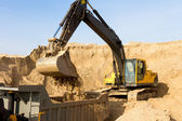 Excavator Loading Dumper Truck — Stock Photo