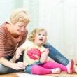Mother with a little daughter drawing — Stock Photo