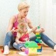 Mother with a little daughter playing — Stock Photo