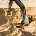 Yellow Excavator at Construction Site — Stock Photo #26585187