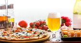 Composition of beer sushi and pizza — Stock Photo