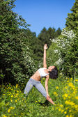 Young woman doing yoga outdoor — Stock Photo