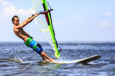Fast approaching windsurfer — Stock Photo