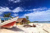Abandoned fishing boat on a beach — Stock Photo