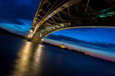 Bridge on a quiet night, tilted horizon — Stock Photo