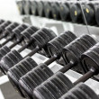 Stand with dumbbells — Photo