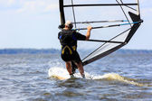 Rear view of young windsurfer — Stock Photo