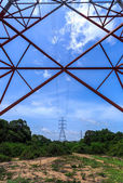 Inside of a power pylon and look into the sun — Stock Photo