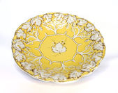 Antique yellow gold porcelain dish with grape pattern — Stock Photo