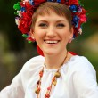 Young woman in traditional Ukrainian costume — Stock Photo #10650659