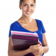 Portrait of a young beautiful girl holding files and standing against white background — Stock Photo