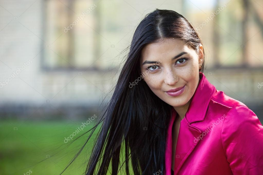 Portrait of a beautiful young woman outdoors   Stock Photo #12760011