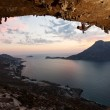 Silhouette of a rock climber against picturesque view of Telendos Island at sunset — Stock Photo #13609243