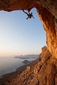 Rock climber at sunset, Kalymnos Island, Greece — Stock fotografie