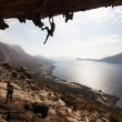 Rock climber climbing at the rock , Kalymnos Island, Greece - Stock Photo