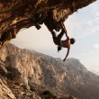 Rock climber at sunset, Kalymnos Island, Greece - Stock Photo