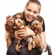 Cute young girl holding Yorkshire terrier dogs on her lap Cute young girl holding Yorkshire terrier dogs on her lap — Stock Photo #14739927