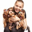 Cute young girl holding Yorkshire terrier dogs on her lap Cute young girl holding Yorkshire terrier dogs on her lap — Stock Photo