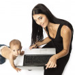 Young beautiful woman and little boy over white. The woman holding a laptop. — Stock Photo