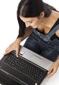 Young beautiful woman working on laptop, view from above — Stock Photo