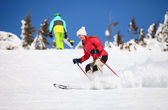 Young female skier on a snowy slope — Stock Photo