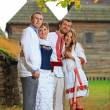 Two young couples in Ukrainian style clothing posing outdoors — Stock Photo #15634243