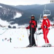 Stock Photo: Young couple standing on ski slope
