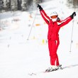 Portrait of happy female skier on mountain slope — Stock Photo #15802919