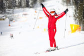 Portrait of happy female skier on mountain slope — Stock Photo