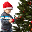 Cute little boy decorating Christmas tree — Stock Photo