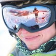 Closeup portrait of a female skier standing on a skiing slope — Foto Stock
