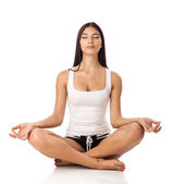 Young woman sitting in lotus position — Stock Photo