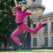 Woman jump in a park - Stock Photo