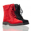 Red and black female boots - Stock Photo