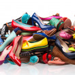 Pile of various female shoes over white — Stok fotoğraf #19690597