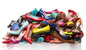 Pile of various female shoes over white — Stock Photo
