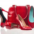 Red fashion women shoes and handbag over white — Stock Photo