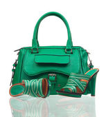 Green summer shoes and handbag over white — Stock Photo