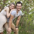 Young pregnant couple outdoors in spring — Stock Photo