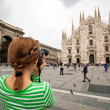 Stock Photo: Womtaking picture of Duomo di Milano, Italy