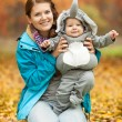 Young woman and baby dressed in elephant costume — Stock Photo