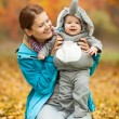 Young woman and her baby boy dressed in costume — Stock Photo