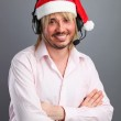 Caucasian man wearing headset with christmas hat — Stock Photo #35948651