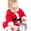 Little boy in Santa costume with alarm clock — Stock Photo