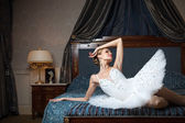 Ballerina lying down on bed and daydreaming — Stock Photo