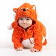 Baby boy in fox costume looking at camera on white — Stock Photo