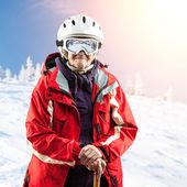 Senior woman in ski jacket and goggles outdoors — ストック写真